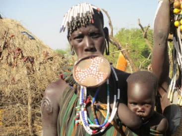 Mursi wearing a large. clay lip plate